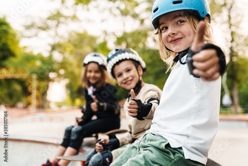 Happy cheerful kids with skateboards at the ramp