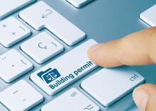Building Permit - Inscription On Blue Keyboard Key.