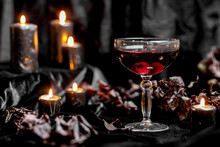 Red Gothic Halloween Drink With Candy Eyeballs And Candles