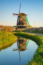 Windmill Reflecting In A River, Open-air Museum, Zaanse Schans, Zaandam, North Holland, Netherlands