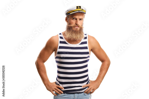 Fototapeta Serious young sailor captain with beard and moustaches
