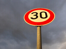 Traffic Sign In Germany At A Dark Sky With Speed Limit 30