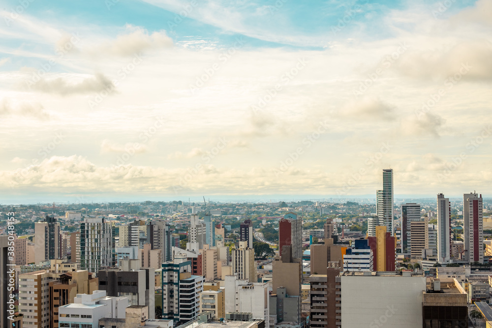 Fototapeta Aerial view of urbanized center with colorful skyscrapers in the morning - Curitiba, capital of Paraná state, Brazil