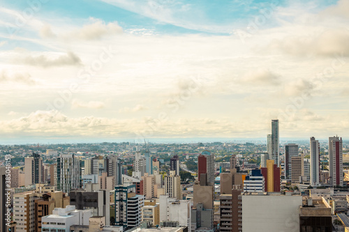 Aerial view of urbanized center with colorful skyscrapers in the morning - Curit Fotobehang