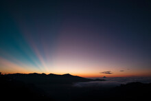 View Of A Colorful Sunrise, Where You Can See A Layer Of Clouds And Some Rays Of Sun