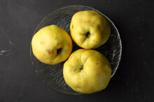 Three Quinces On A Glass Plate...