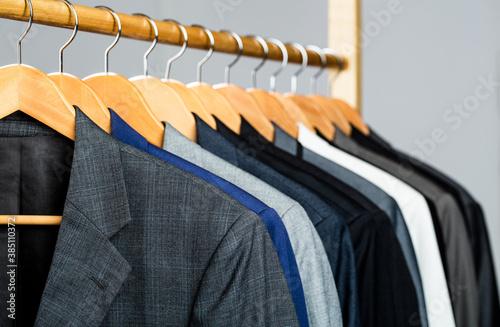 Fotografie, Obraz Suits for men hanging on the rack