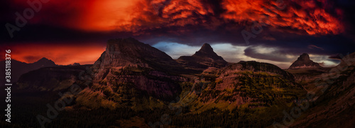 Obraz Beautiful Panoramic View of American Rocky Mountains. Dramatic Colorful Sunset Artistic Render. Landscape: Glacier National Park, Montana, United States. - fototapety do salonu