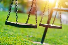 Empty Chain Swing In Children Playground. Vintage Filter