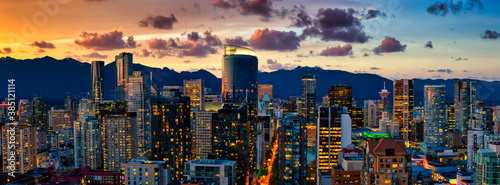Aerial Panorama of the beautiful modern downtown city during the night after sunset. Vancouver, British Columbia, Canada. Colorful Clouds Artistic Render