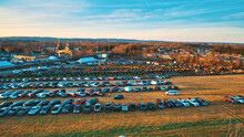 Aerial View Of An Amish Mud Sale With Lots Of Buggies And Farm Equipment On A Early Morning Winter Day