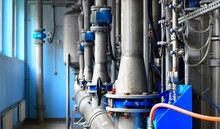 Large Industrial Water Treatment And Boiler Room. Piping, Flanges, Butterfly Valves, Rusty And Corroded Bolts