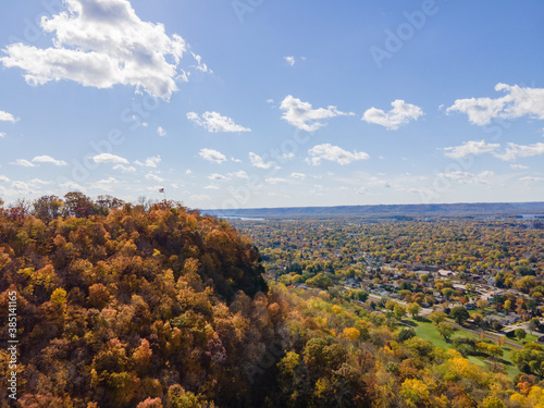 autumn landscape of the bluffs in lacrosse, Wisconsin with trees and clouds over Canvas Print