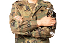 Closeup Of A Military Doctor With A Stethoscope  His Hand. The Man Is Wearing Camouflage Fatigues Also Called ACU And Has His Arms Crossed.
