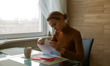 Attentive Woman Taking Letter ...