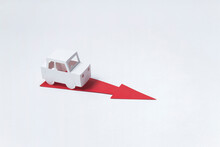This Way! A Paper Craft Car Follows The Direction Of A Red Arrow