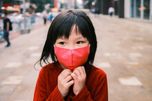 Little Girl Wearing A Mask