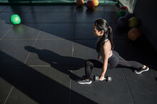 Pretty Asian Woman Working Out...