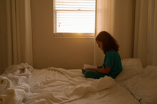 Girl Reading In The Morning Light