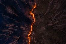 Fire Spreading Across Dark For...