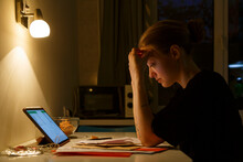 Tired Woman Working With Papers At Night