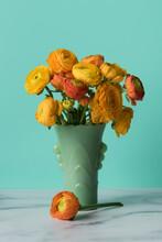 Orange Ranunculus On Marble An...