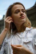 Woman In Headphones Talking On The Phone