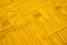 Yellow Cutlery In Pleasing Pat...