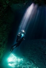 Diver In A Cave, Sun Rays, Isl...