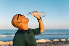 Senior Man Drinking Water Whil...