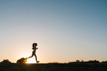 Silhouette Of Woman Running Ag...