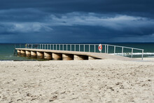 Empty Jetty At Beach Against C...