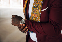 Young Man Wearing Traditional Kente On Suit While Standing In Building