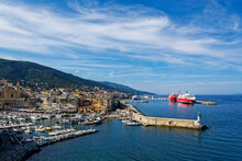 France, Haute-Corse, Bastia, Harbor Of Coastal Town With Cruise Ship In Background