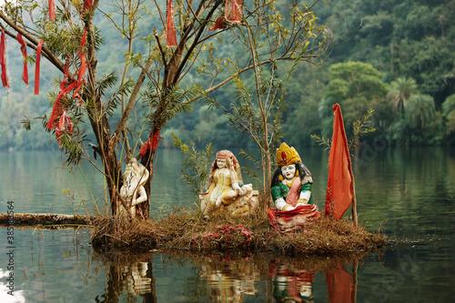 Obraz God under tree in lake - fototapety do salonu