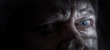 Detail Of A Portrait Of An Elderly Man. He Has An Intense, Evil Look.
