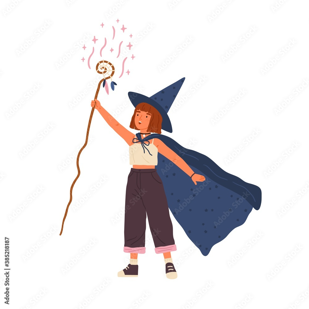 Fototapeta Cute girl wearing witch hat and cloak conjures with magic stick. Young female wizard or sorcerer. Adorable little magician with red hair. Flat vector cartoon illustration isolated on white