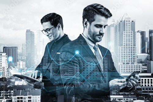 Leinwand Poster Two entrepreneurs in suits working on new venture capital and hi-tech start up and try to forecast risks and estimate prospective earning growth