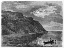 High Cliff And Calm Water Sailed By Little Canoe Silhouette At Night In  Lake Pepin, United States Of America. Ancient Grey Tone Etching Style Art By Huet, Published On Le Tour Du Monde, Paris, 1861