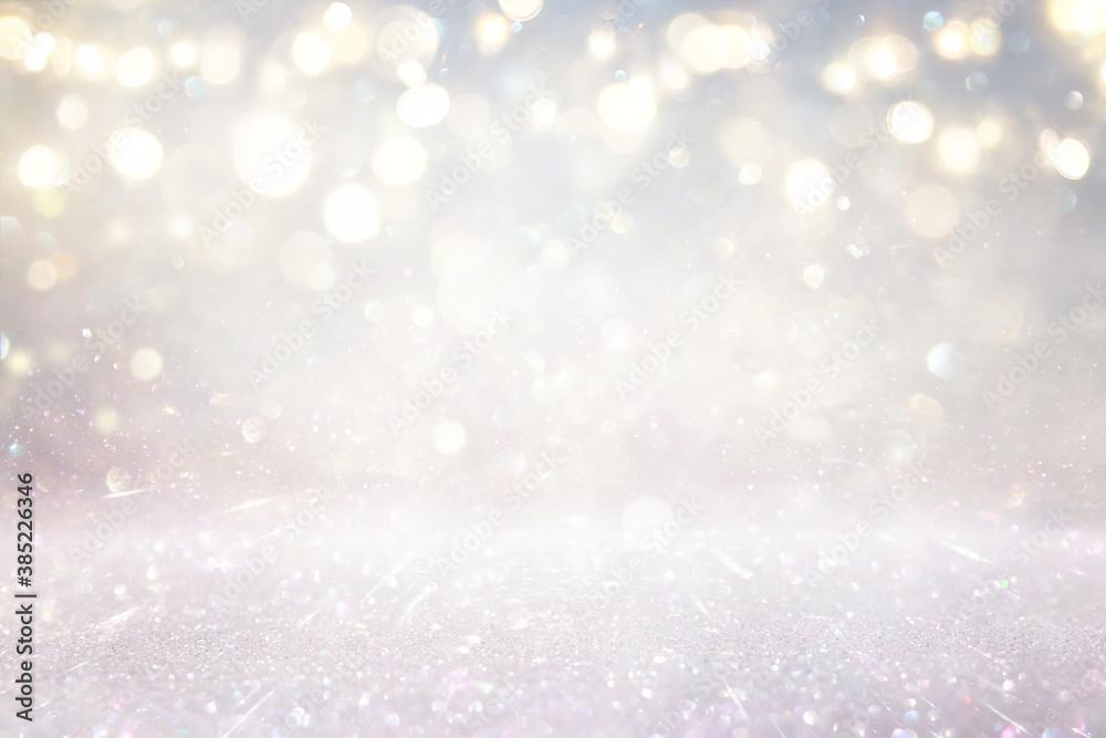 Fototapeta glitter vintage lights background. silver, gold and white. de-focused