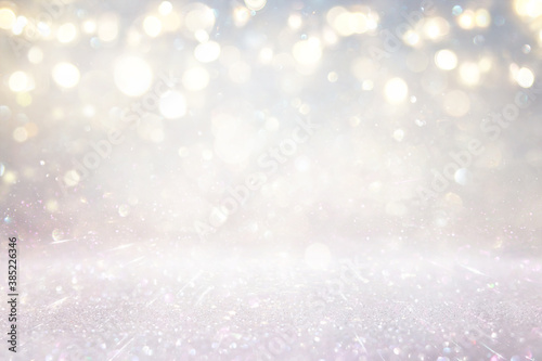 glitter vintage lights background. silver, gold and white. de-focused - 385226346