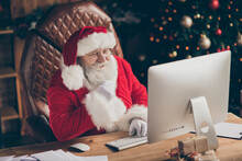 Fairy Jolly Holly Santa Claus Sit Table Work Computer Look Screen Read Wish List Letter Gift Present Email Touch Hand Grey Beard In House Indoors X-mas Christmas Ornament Wear Cap Headwear