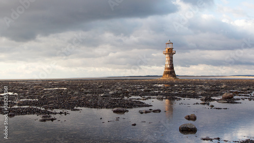 Whiteford Lighthouse is listed by Cadw as Grade II* A wave-swept cast-iron lighthouse in British coastal waters and an important work of cast-iron engineering and nineteenth-century architecture Fototapet