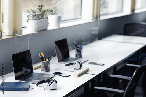 Fototapeta Coworking office interior, employees left room for meeting or break, nobody obraz