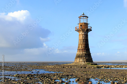 Photo Whiteford Lighthouse is listed by Cadw as Grade II* A wave-swept cast-iron lighthouse in British coastal waters and an important work of cast-iron engineering and nineteenth-century architecture