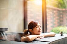 Asian Young Woman Relaxing  In...