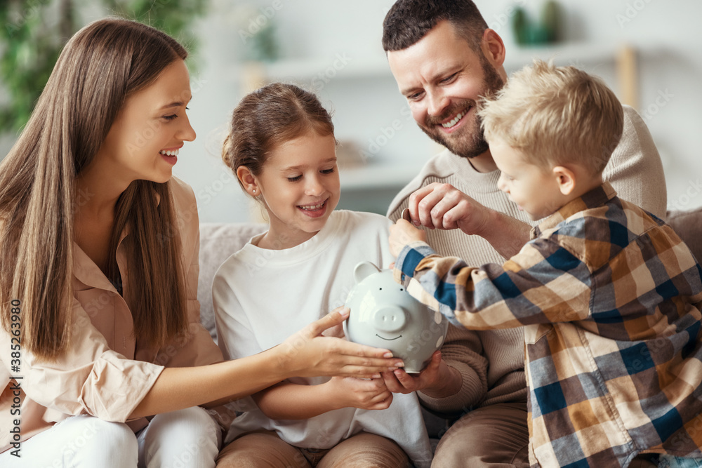 Fototapeta financial planning   family mother father and children with piggy Bank at home