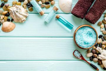 Fototapeta na wymiar Spa treatments set with sea cosmetics - salt and aroma oil. Top view