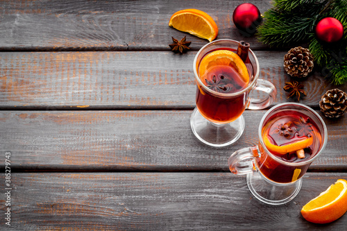 Mulled wine recipe - ingredients for Christmas hot drink in glasses