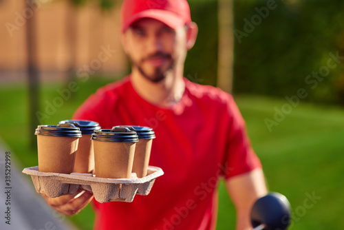 Fototapeta Coffee cups standing on delivering board obraz